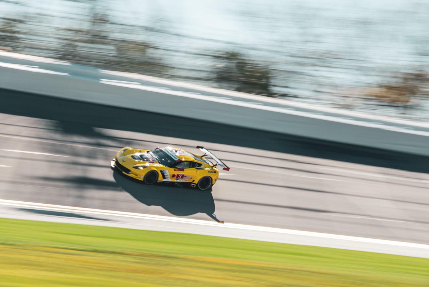 The sun was out for the final practice session on Friday prior to the 24-hour race. One of two Corvette C7Rs hits the high banks of the oval-road course.