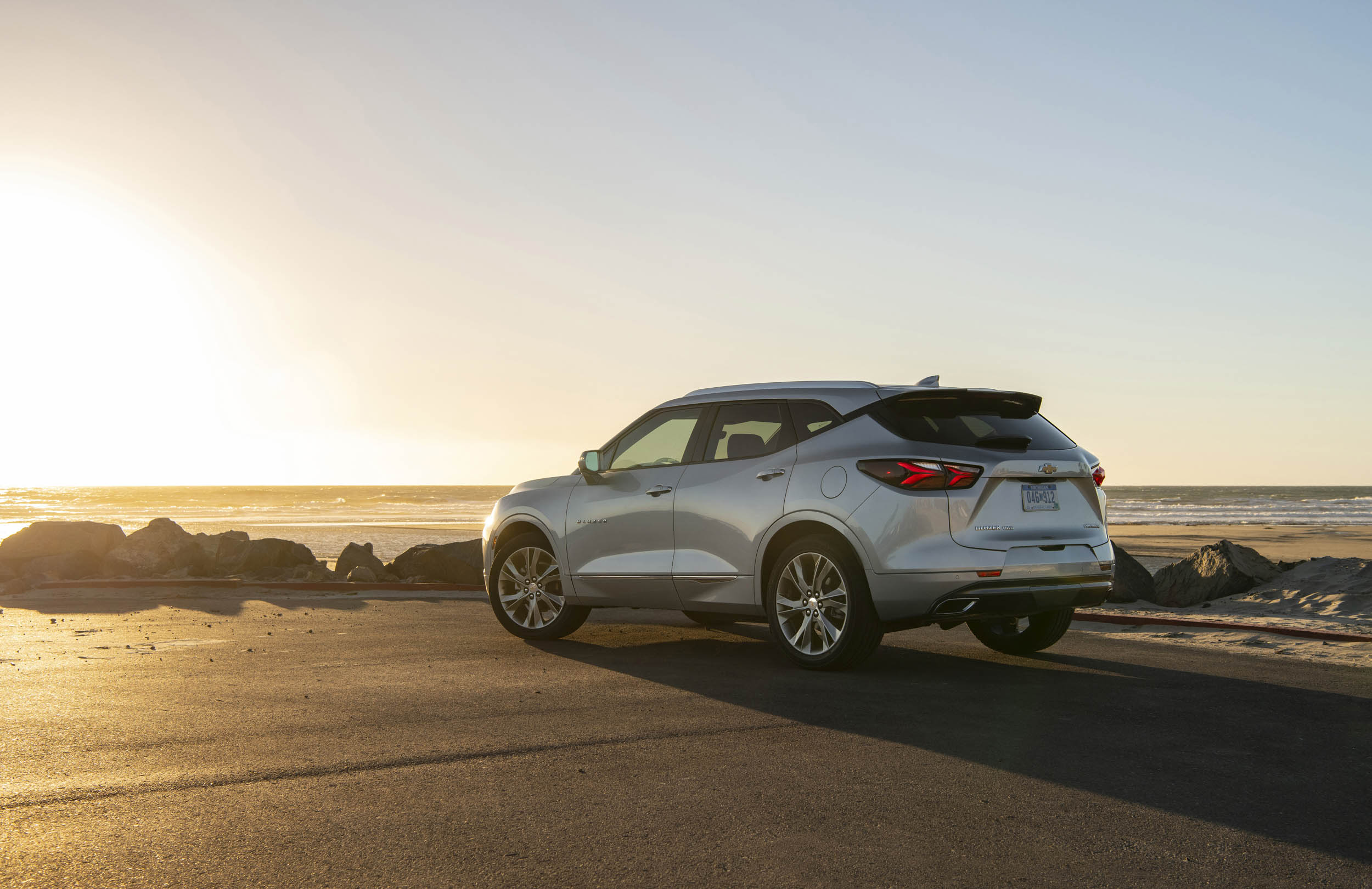 Silver 2019 Chevrolet Blazer rear 3/4 at sunset