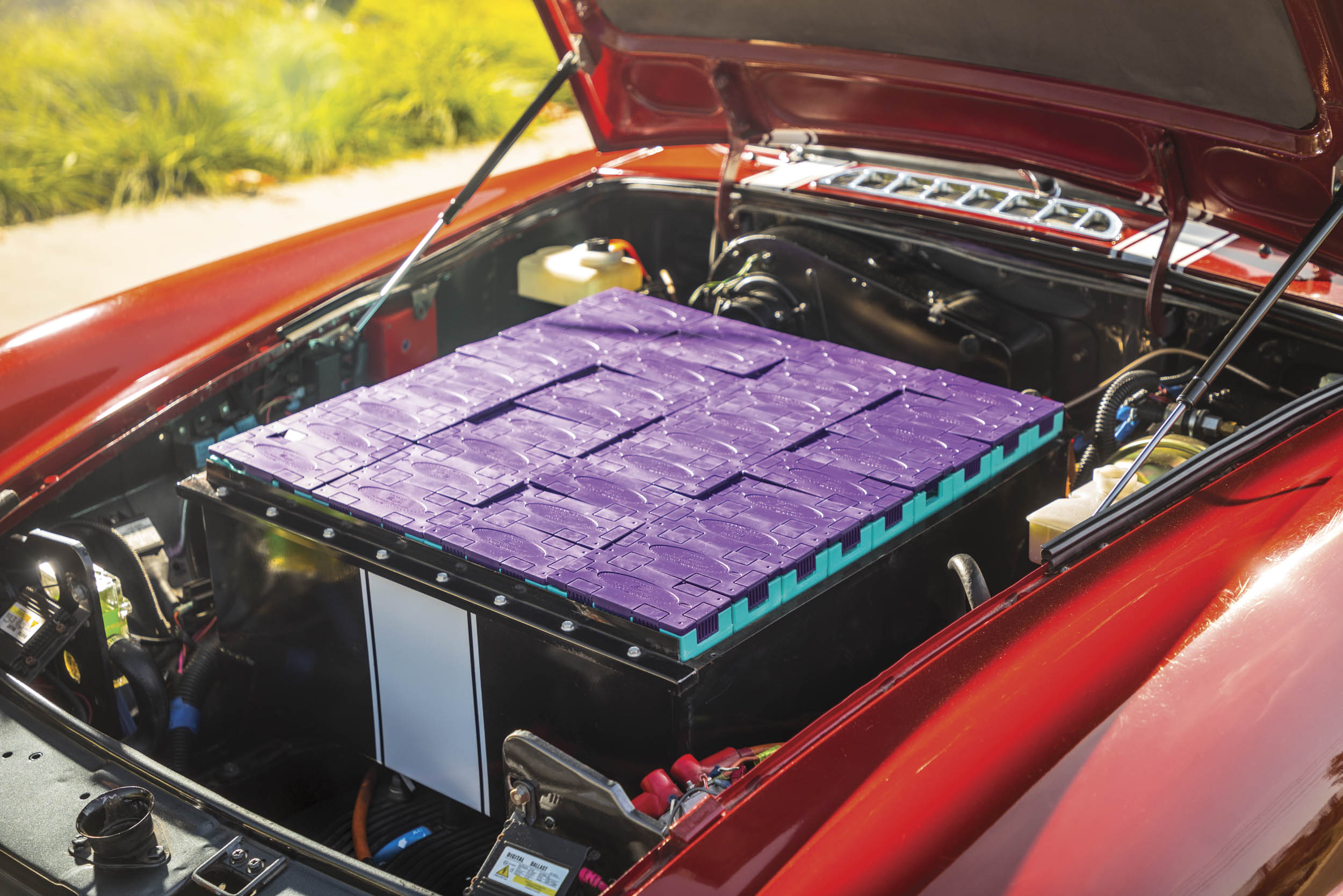 The open hood of Thomas Almodovar's MGB shows off its battery pack.