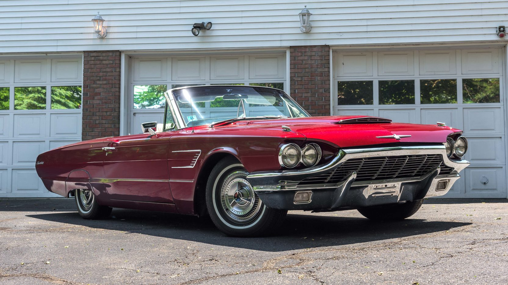 Red 1965 Ford Thunderbird low front 3/4
