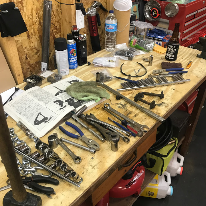 Cluttered workbench dirty tools
