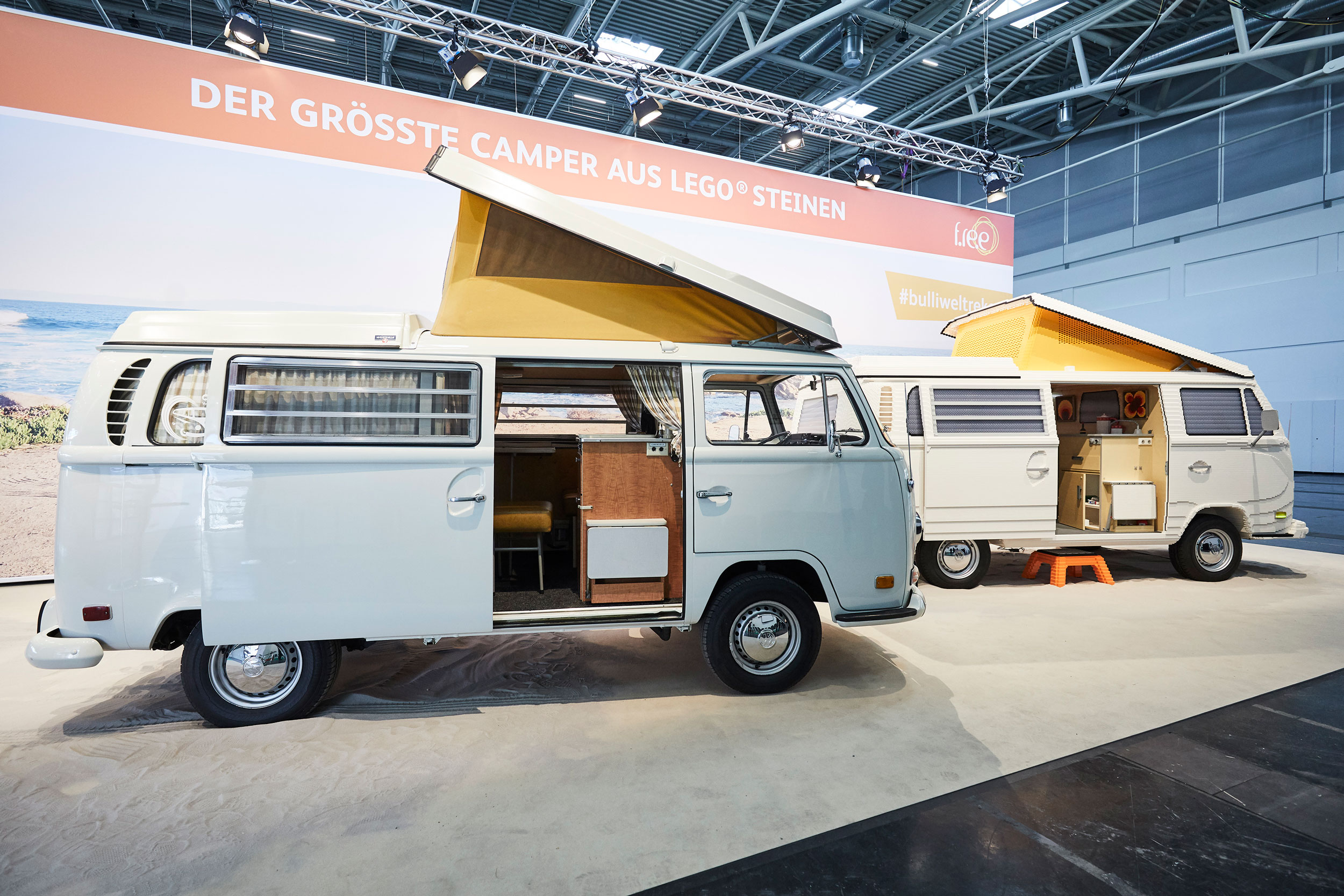 Volkswagen Type 2 next to one made out of 400,000 LEGO bricks