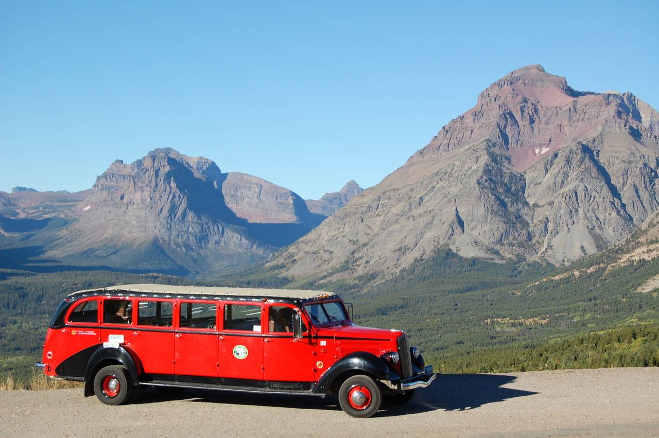 Glacier National Park 3/4 front bus with mountain