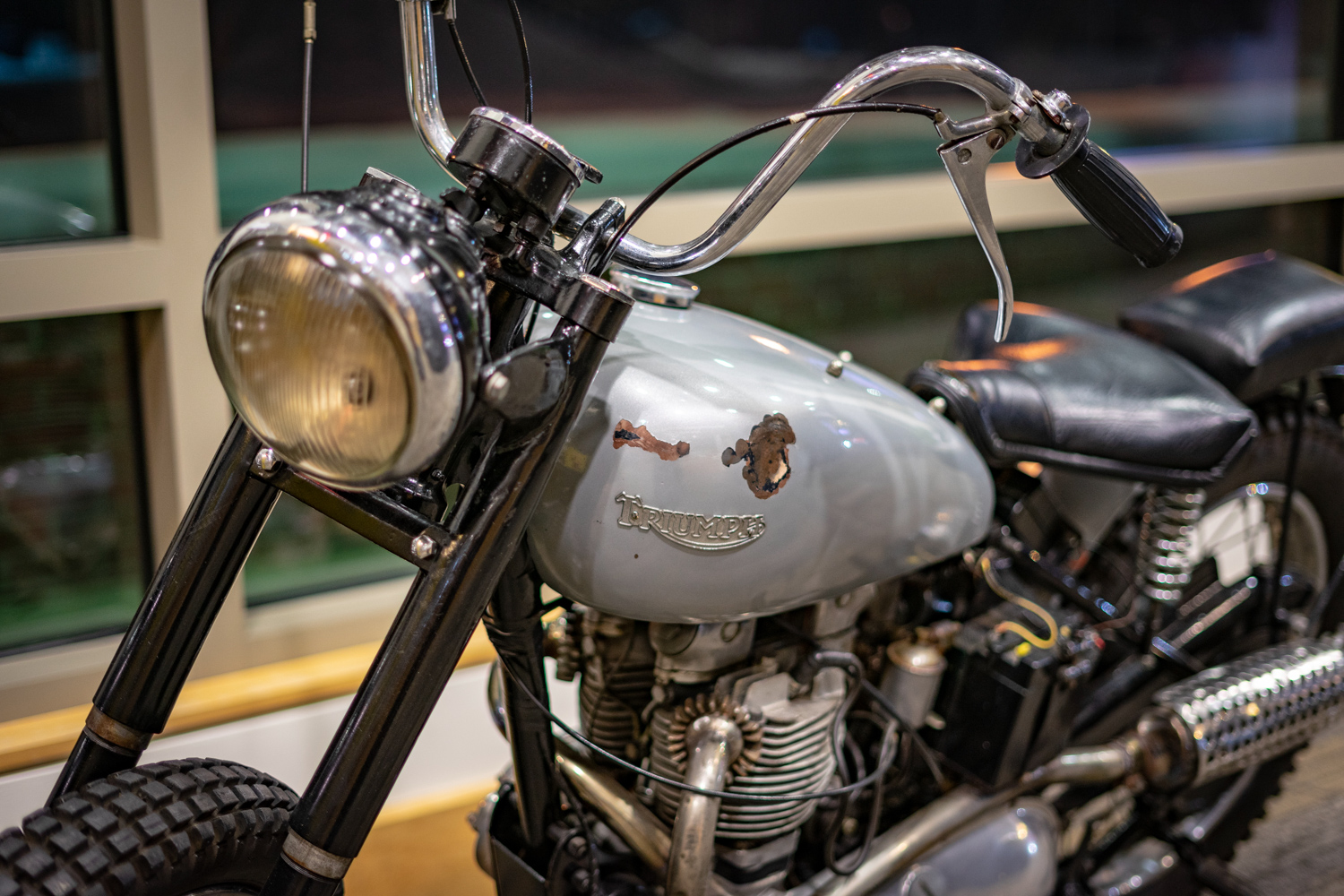 The gas tank on the Happy Days Triumph has some damage, likely from one of Henry Winkler's crash landings. The Fonz may have looked like a skilled rider, but Winkler wasn't.