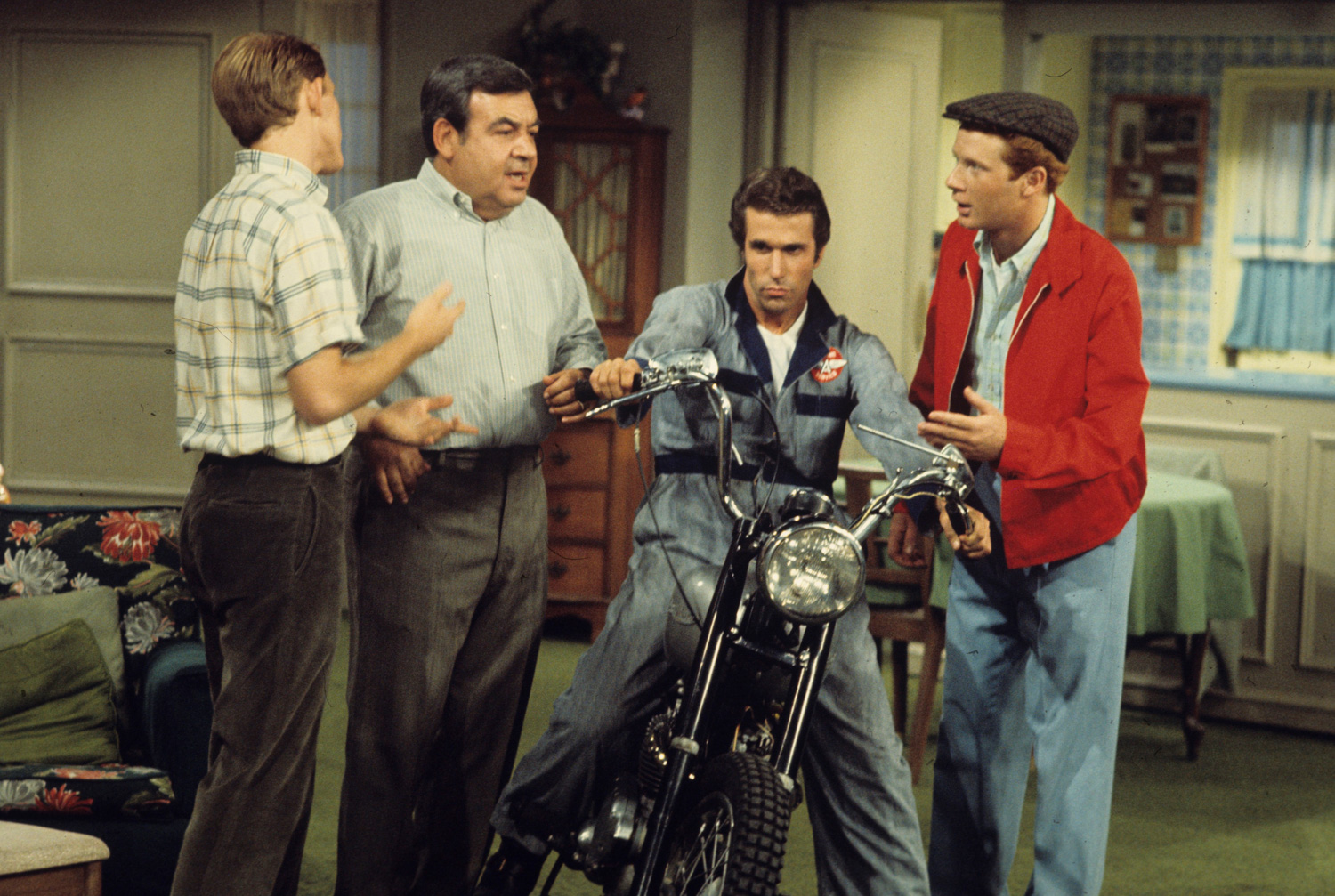 The Fonz with Richie, Mr. C, and Ralph Malph on Happy Days.