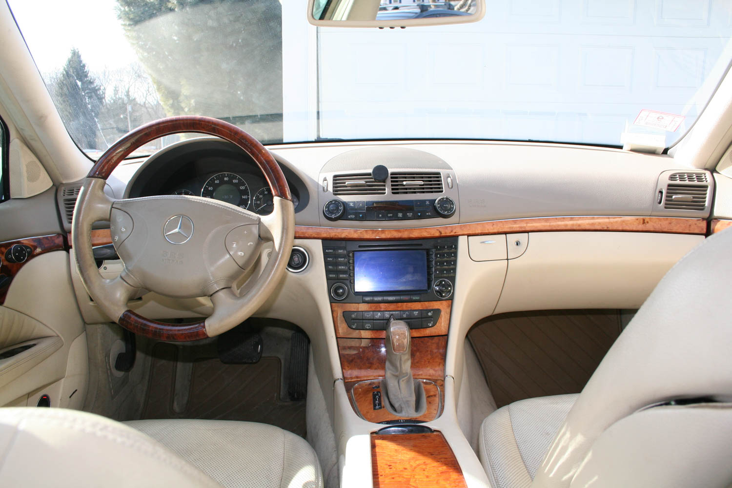The beige interior and burled walnut trim just oozed tranquility.