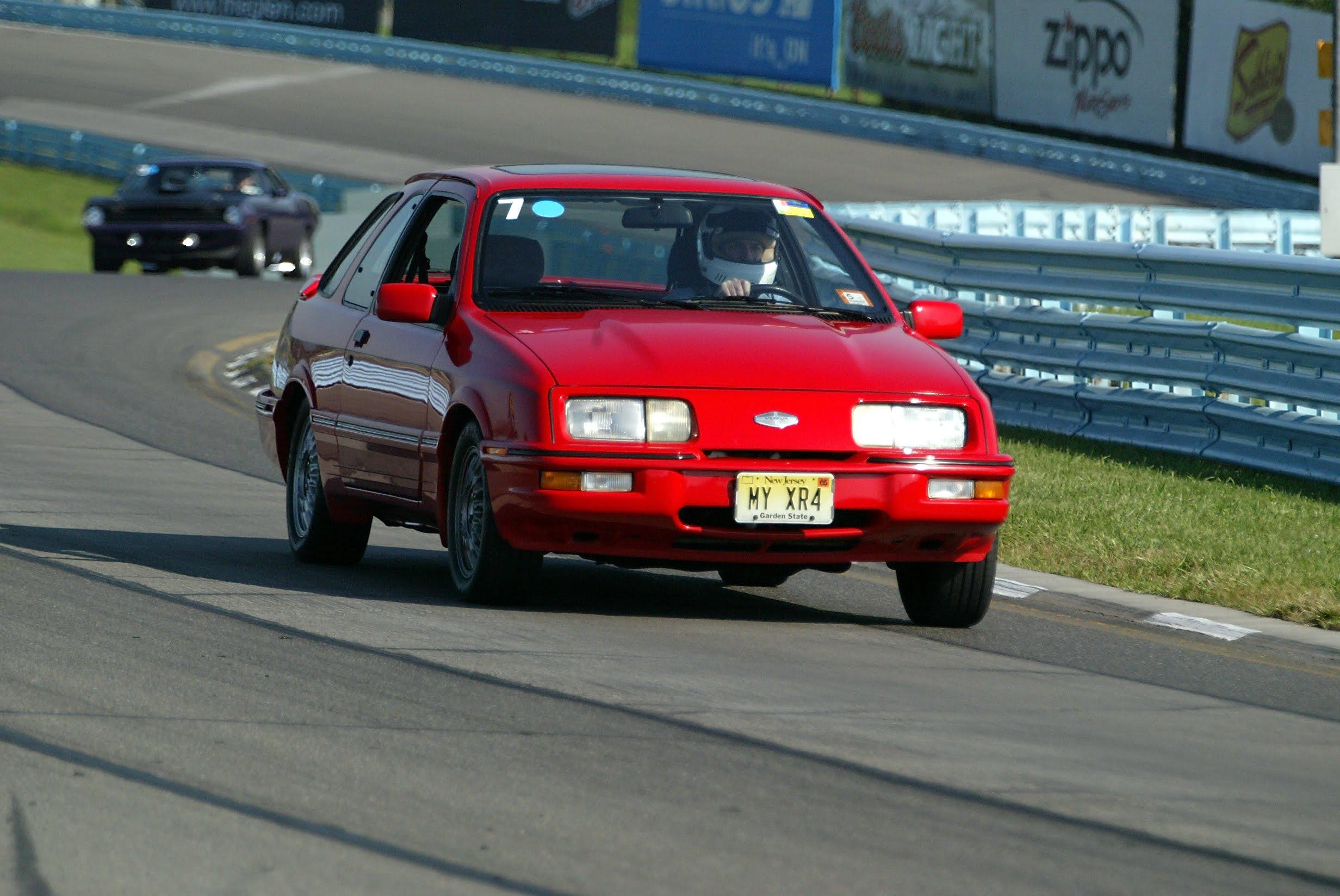 Merkur driving at Watkins Glen