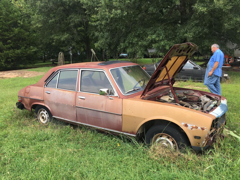 derelict car in field