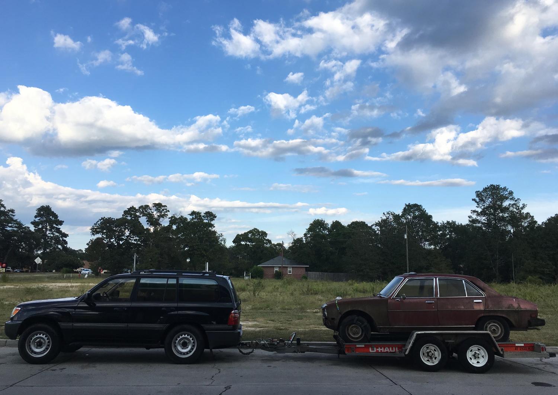 derelict car on trailer