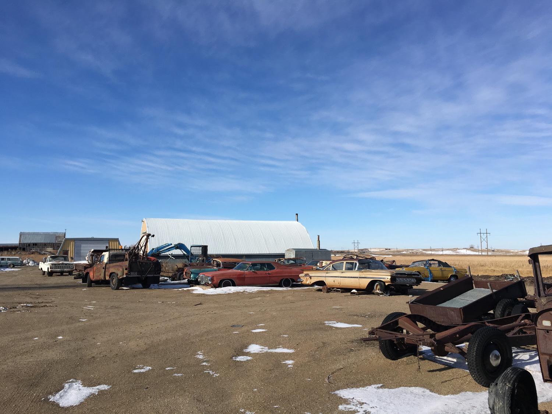 derelict car junkyard snow