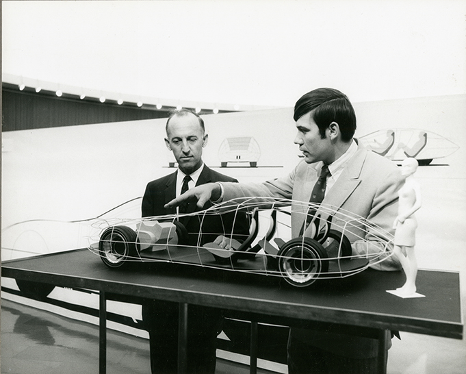 A young Jerry Wiegert shows an unidentified GM Design manager his concept for a four-seat, front- wheel-drive sports tourer.