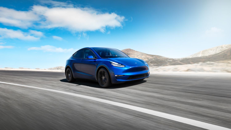 Tesla Model Y 3/4 front blue sky
