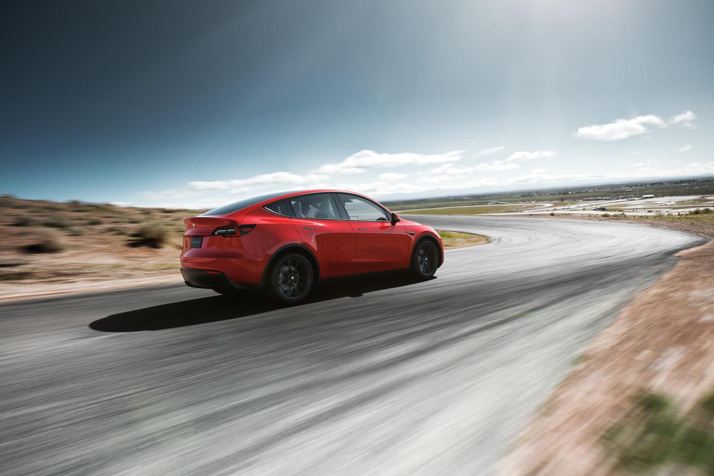 Tesla Model Y red 3/4 rear on track