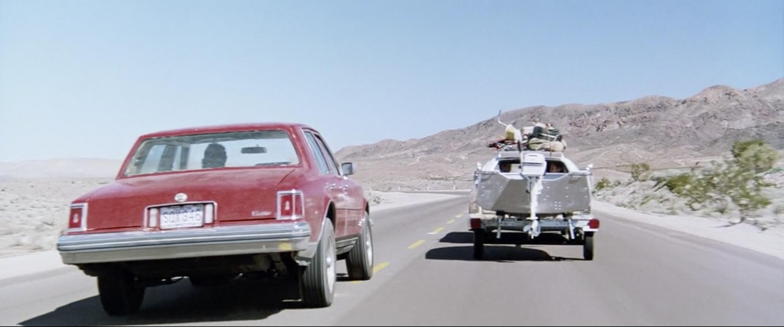 hitcher car chasing boat trailer
