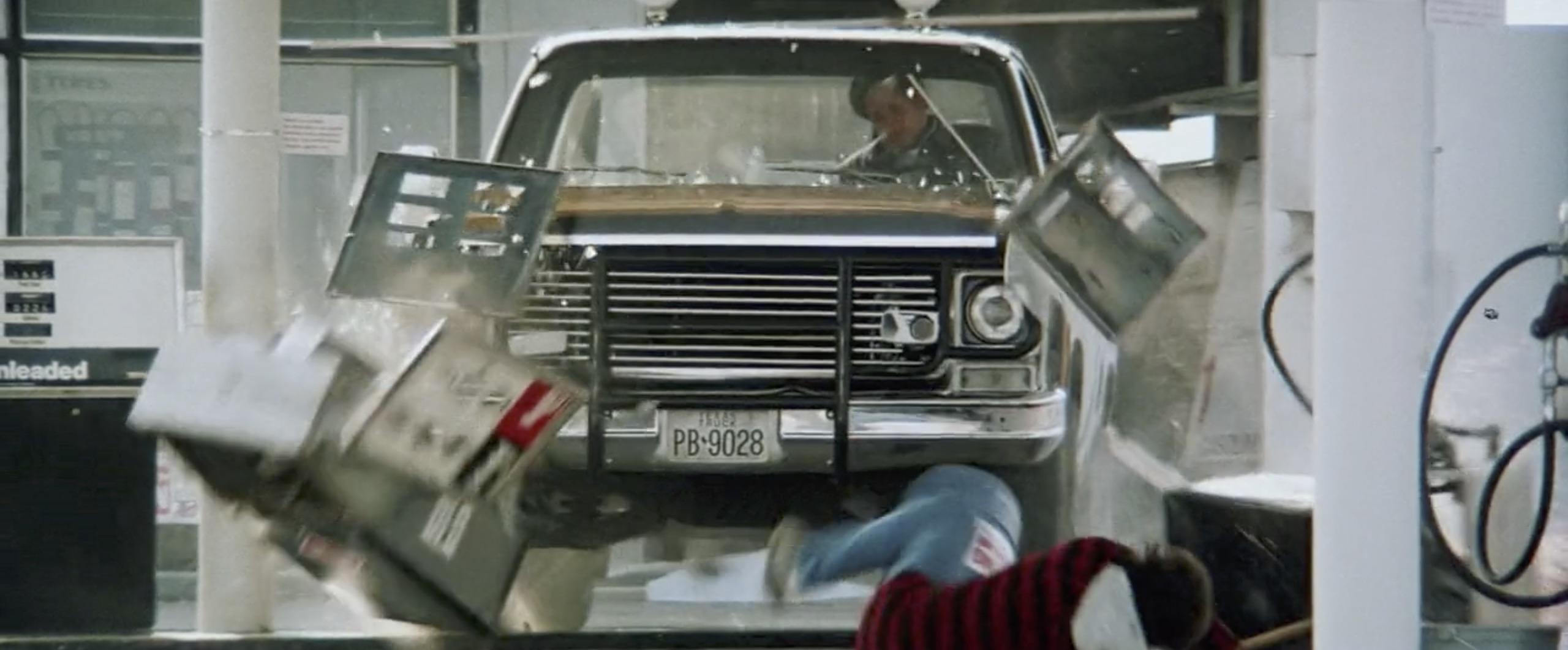 Hitcher running through gas station