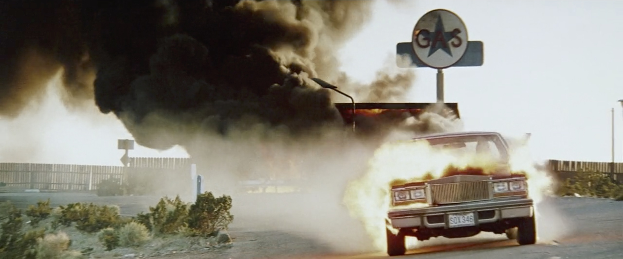hitcher cadillac on fire gas station