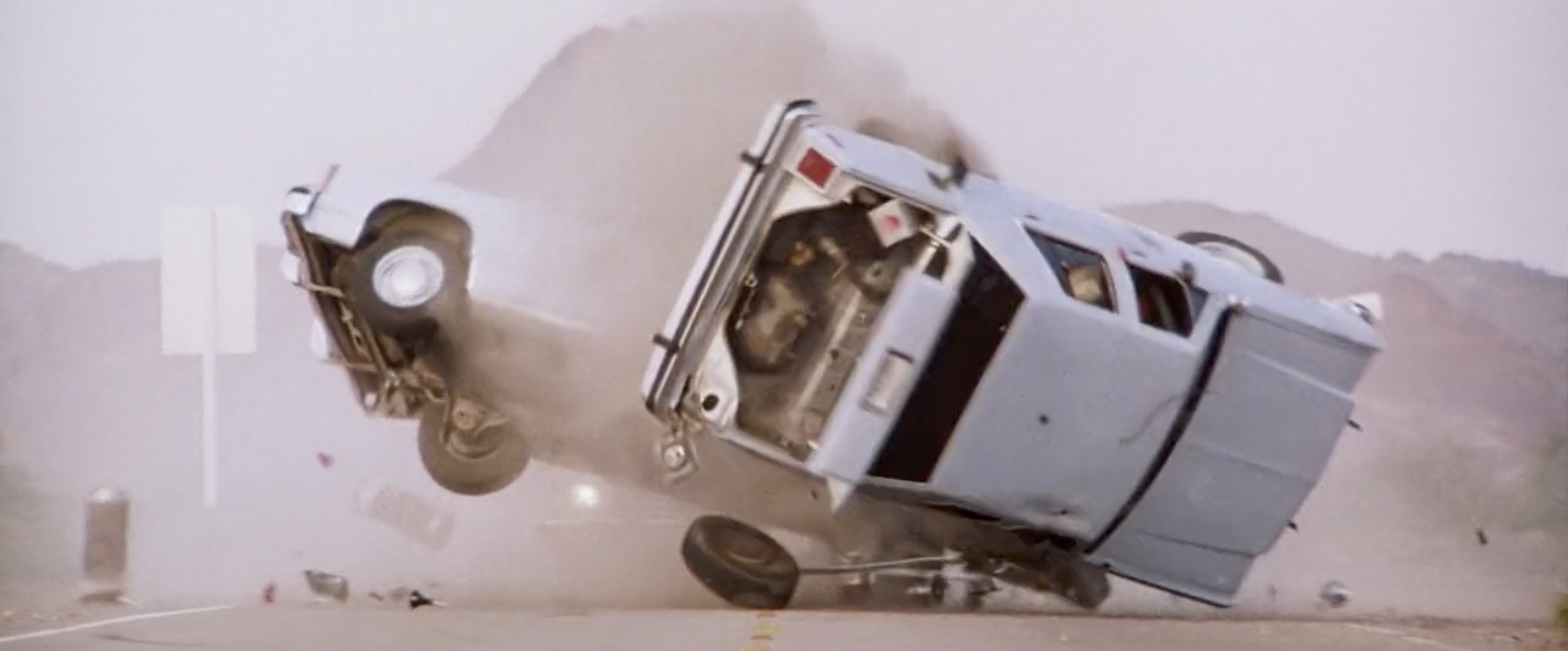 Hitcher cop car roll over