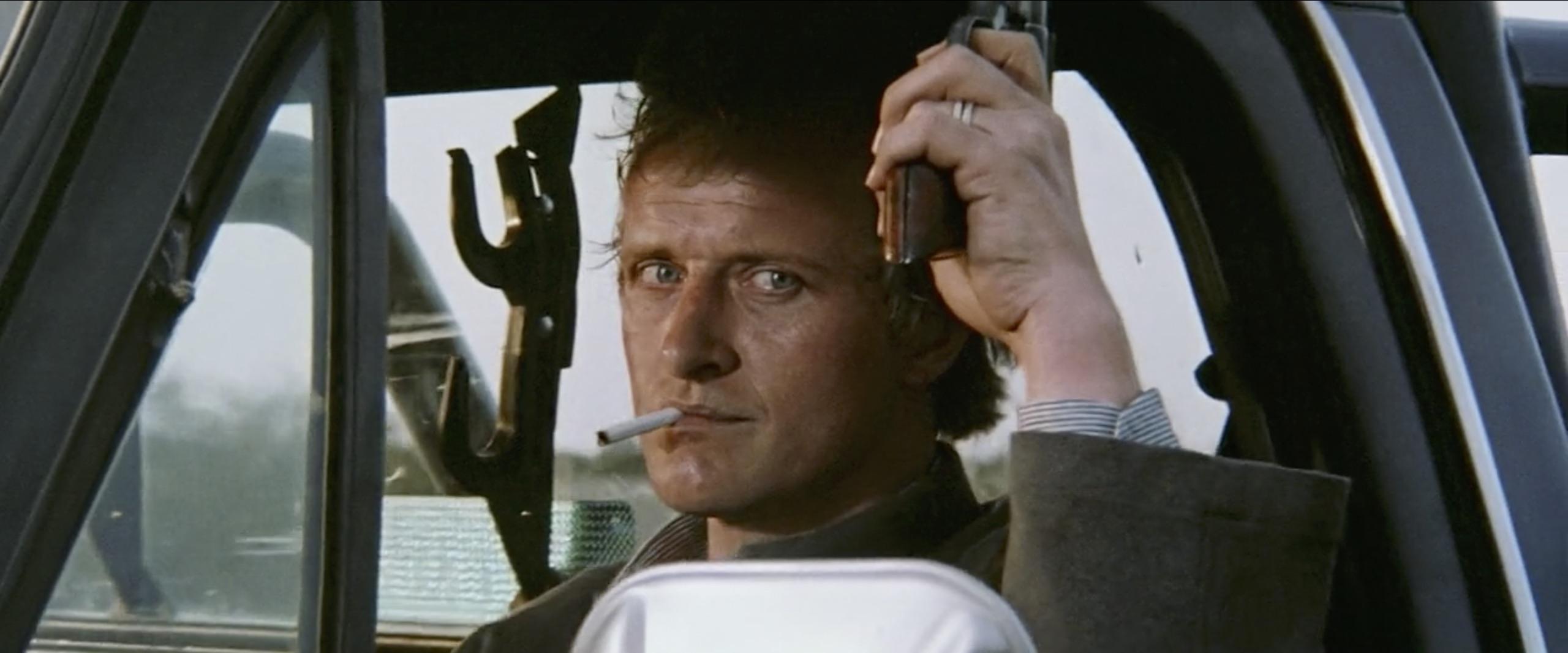 hitcher protagonist with gun
