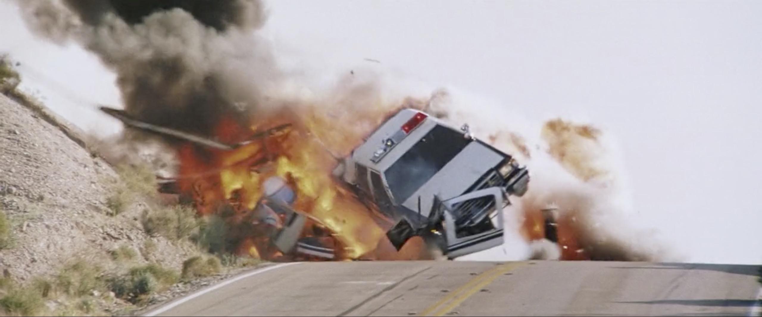hitcher cop car explosion