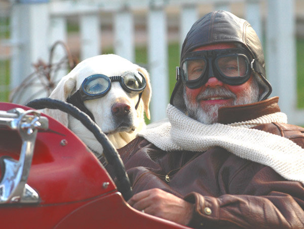 John Russell and his dog, Charlie, take a spin in his 1953 MG TD in 2009. Russell has owned the car for more than five decades.