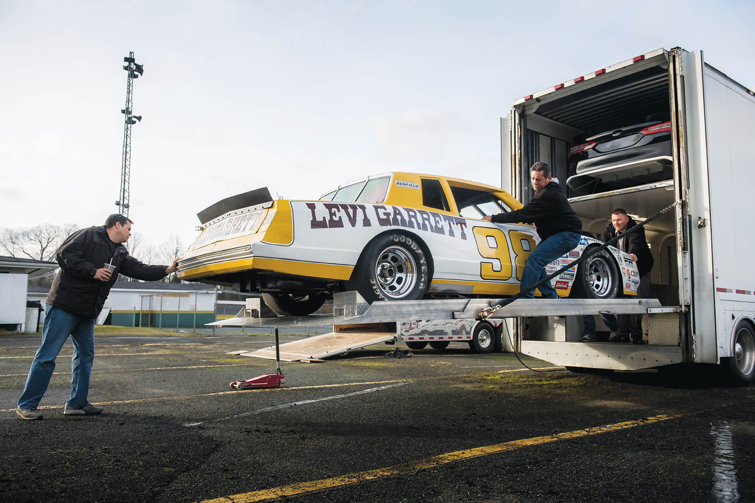 Bill Rhine has restored more than 100 vintage NASCAR racers, including his '84 Monte Carlo. He can tell you from sight if an oil tank is off a 2012 or '13 Hendrick car.