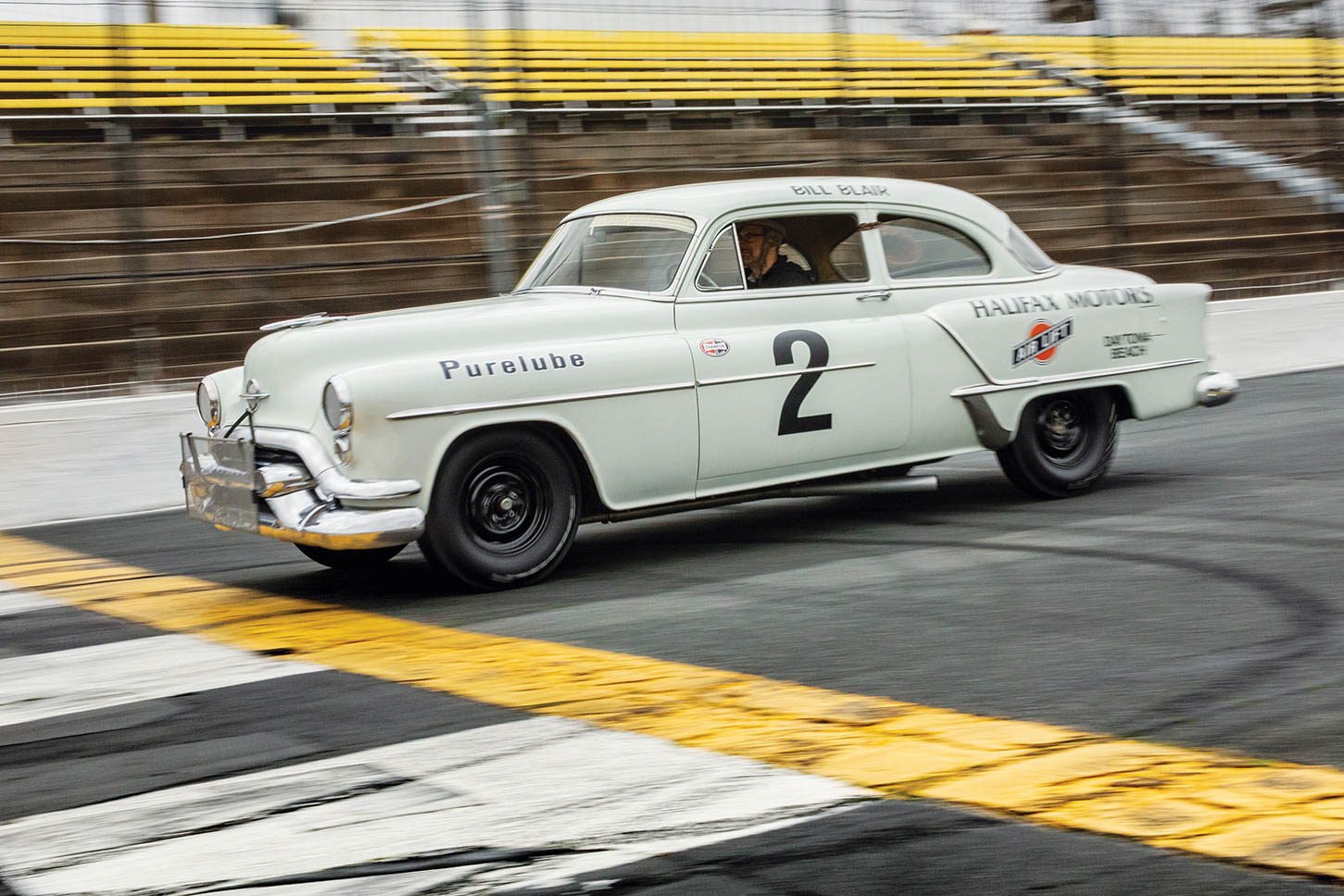 """Bill Blair, Jr.'s, replica of the """"special equipment"""" Olds his daddy raced at Daytona in 1953 is complete down to the leather dog collars holding the doors closed."""