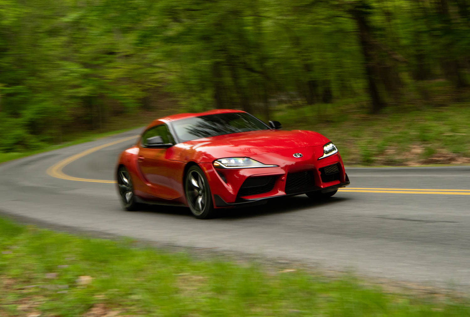 red 2020 Toyota Supra GR driving