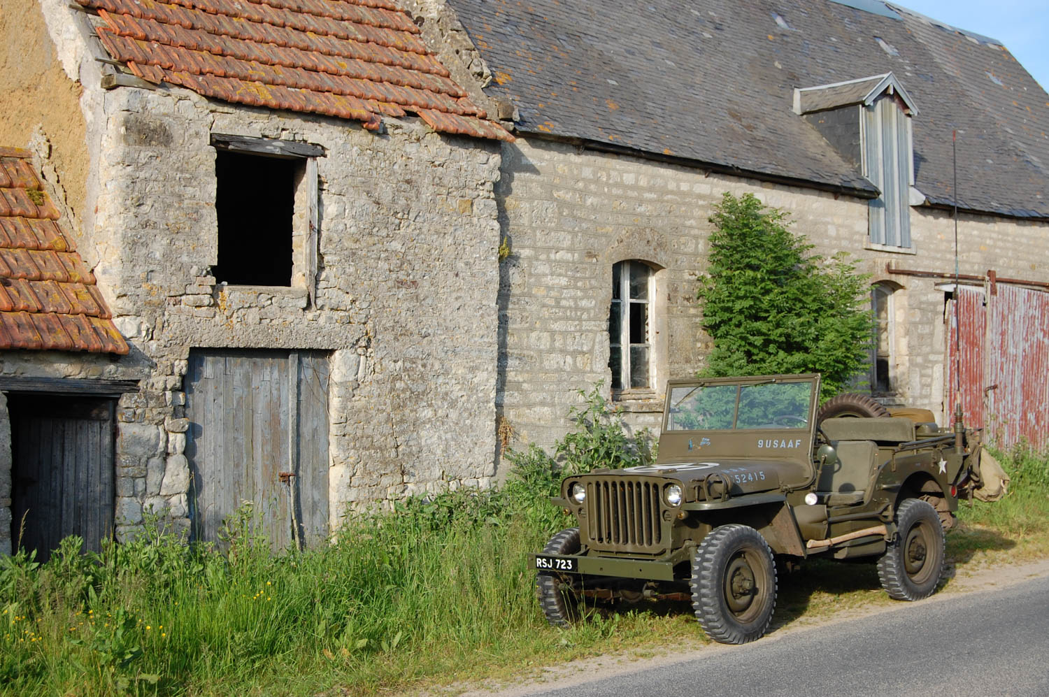 Aaron Robinson's 1944 Ford GPW jeep in front of a farm house near Ste Marie du Mont, where 101st Airborne paratroopers fought the first battles of D-Day in the early hours of June 6, 1944.