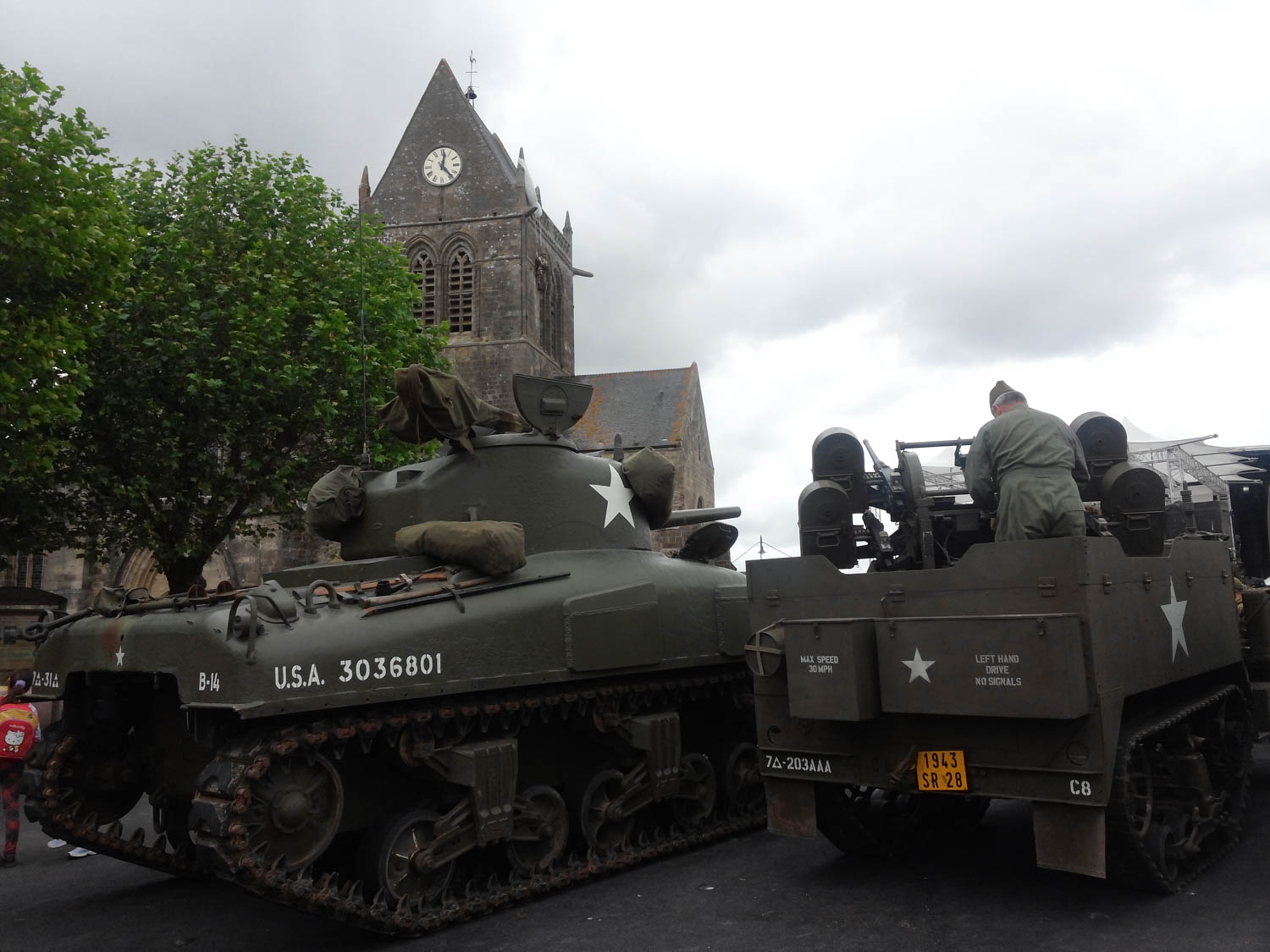 Vintage tanks and half-tracks assemble in the square in front of the church at Ste Mare Eglise in Normandy, where paratroopers from the 101st Airborne landed in the early morning hours of D-Day.
