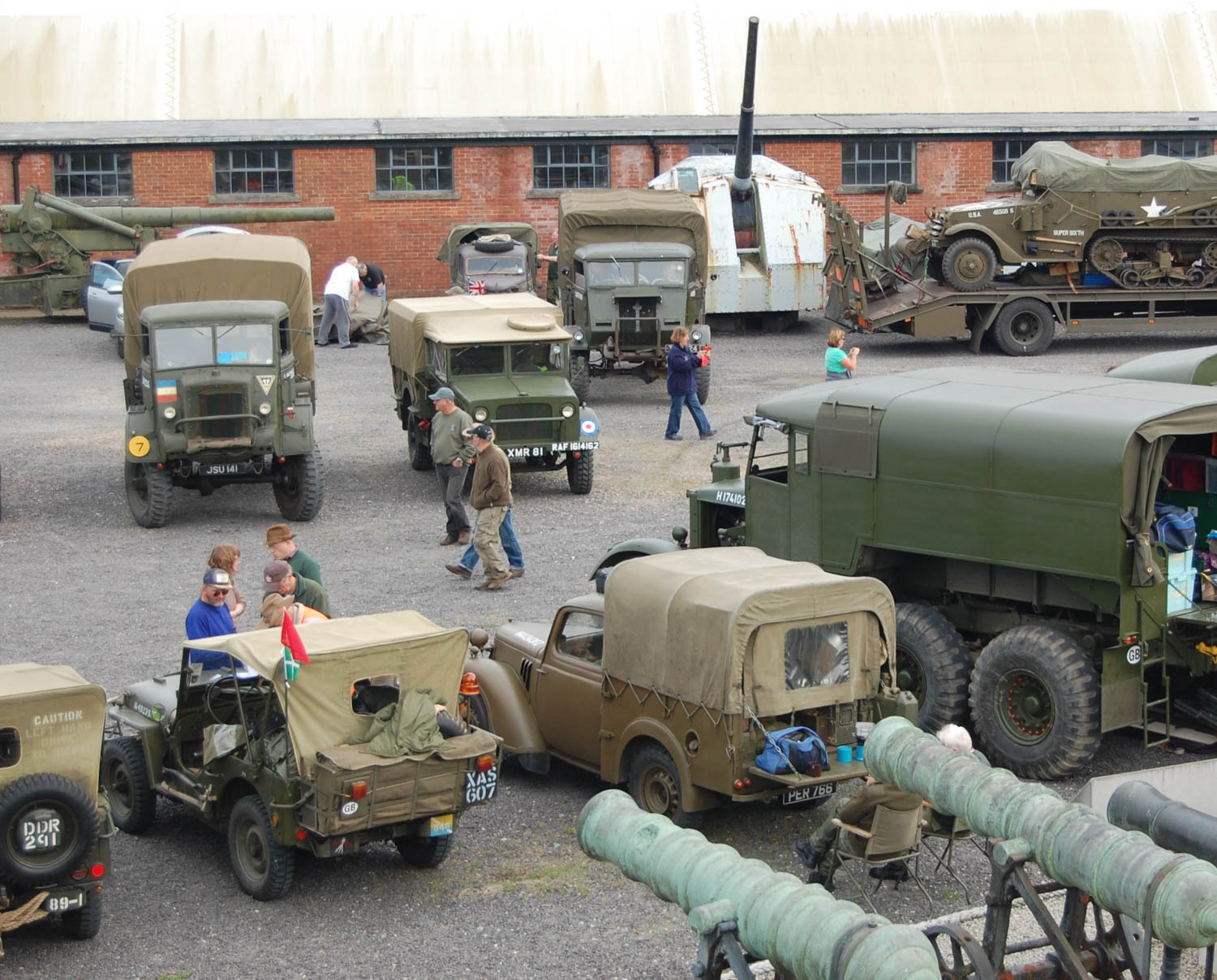 an assortment of Bedford trucks, Austin Tillys, and American jeeps gather at Fort Nelson near Portsmouth.
