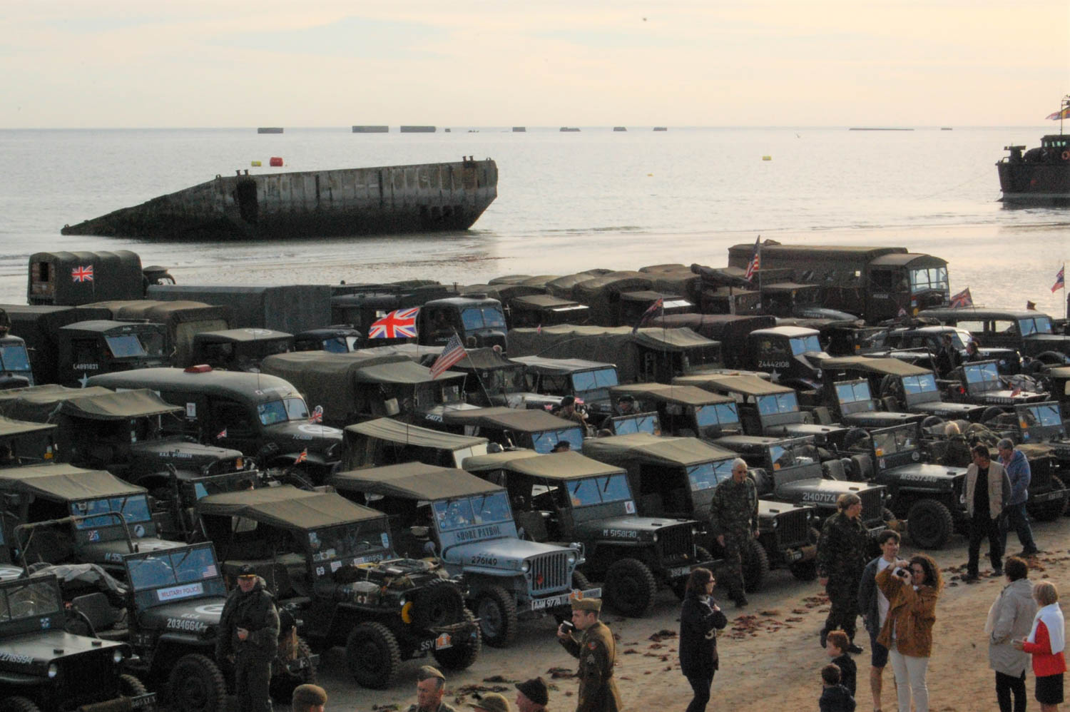 Hundreds of vehicles take the beach at Arromanches in the British sector for a commemoration on June 6, 2014. Behind them is the remains of a Mulberry, part of a system of floating concrete piers that was used to turn Normandy's beaches into a bustling port for war supplies.