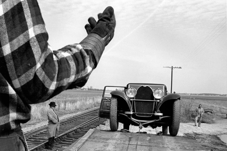 Bugattis loaded onto a train