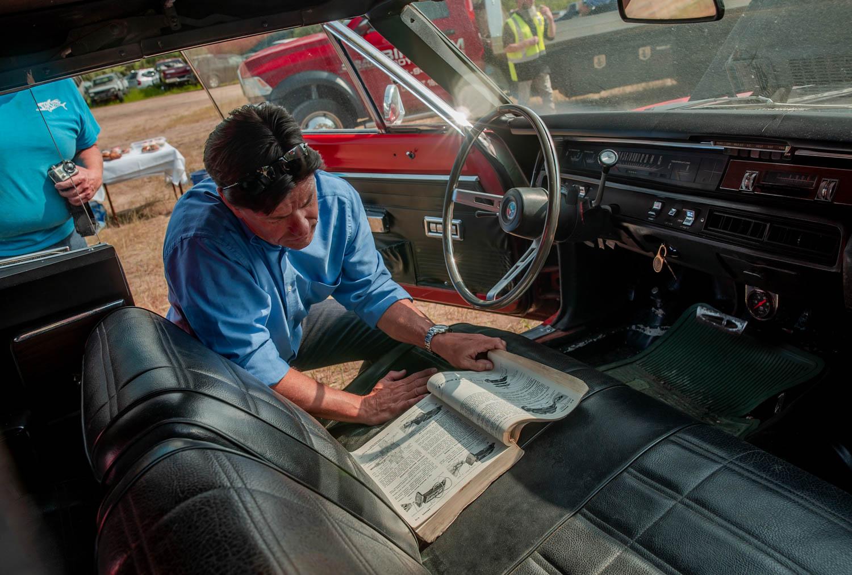 writer Jeff peek taking a look at the car