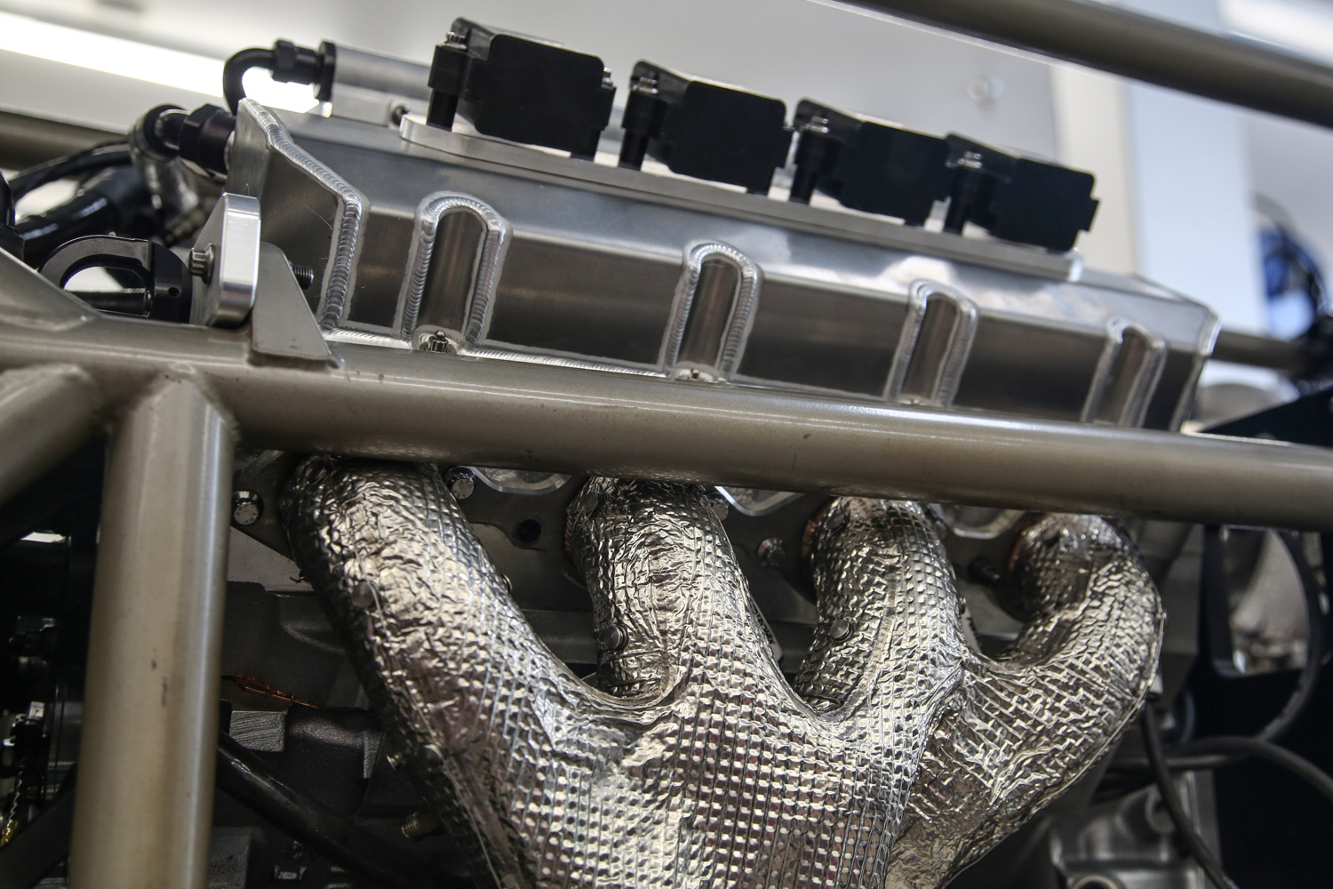 Notice how close the header primary tubes come to the chassis tube. Without lowering the engine the ports would have run directly into the chassis.