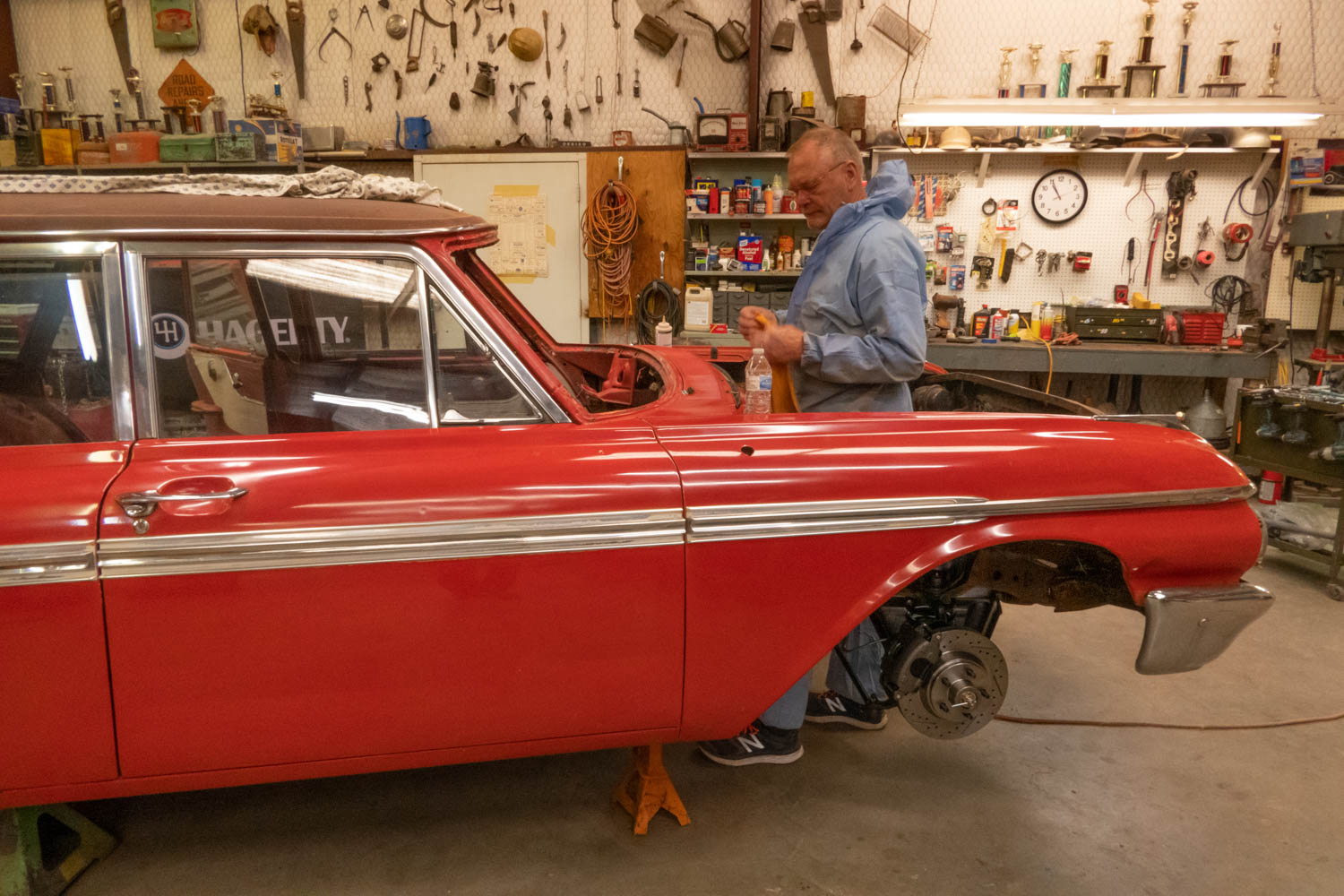 Tom Cotter working on the 1962 Ford Country Sedan