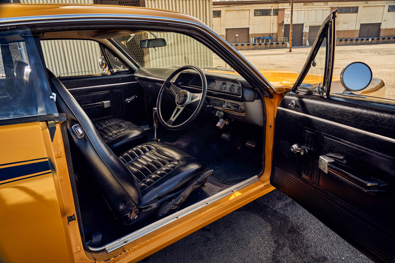 """The three-spoke steering wheel in the Aussie Charger, the tall shifter with its uniquely lefthanded pistol grip (the owner had it made), and the array of pedals with the center one clearly marked """"DISC BRAKES"""" all sit in easy relationship to one another. Driving on the right, though, takes some getting used to."""