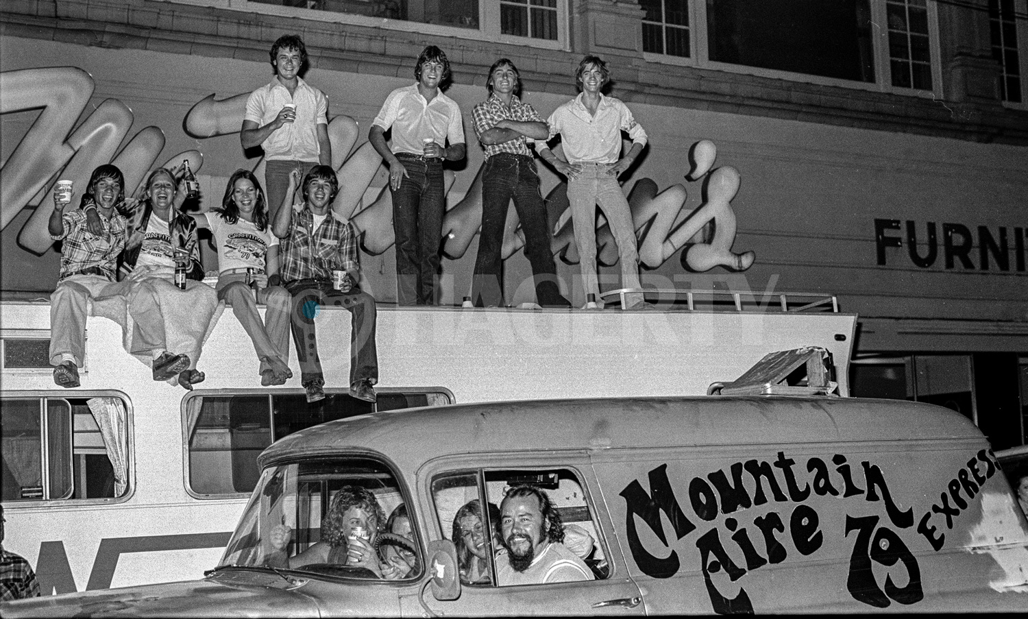 """Golub describes the gang on top of the Winnebago as """"Canal Bank Commandos"""" who would buy cases of beer, drive out to one of the Central Valley's numerous irrigation canals, and get drunk. Looks like they brought the party to downtown Modesto on this night."""