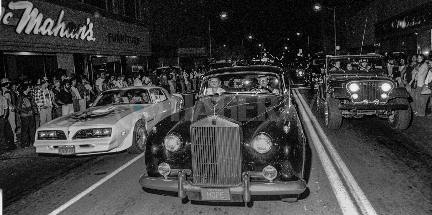 """""""The cars were cruising so slowly that you could walk in front of them,"""" says Golub. The photographer took advantage of the snail's pace to stare down the barrel of this odd trio—a Trans Am, a Rolls-Royce, and a Jeep."""