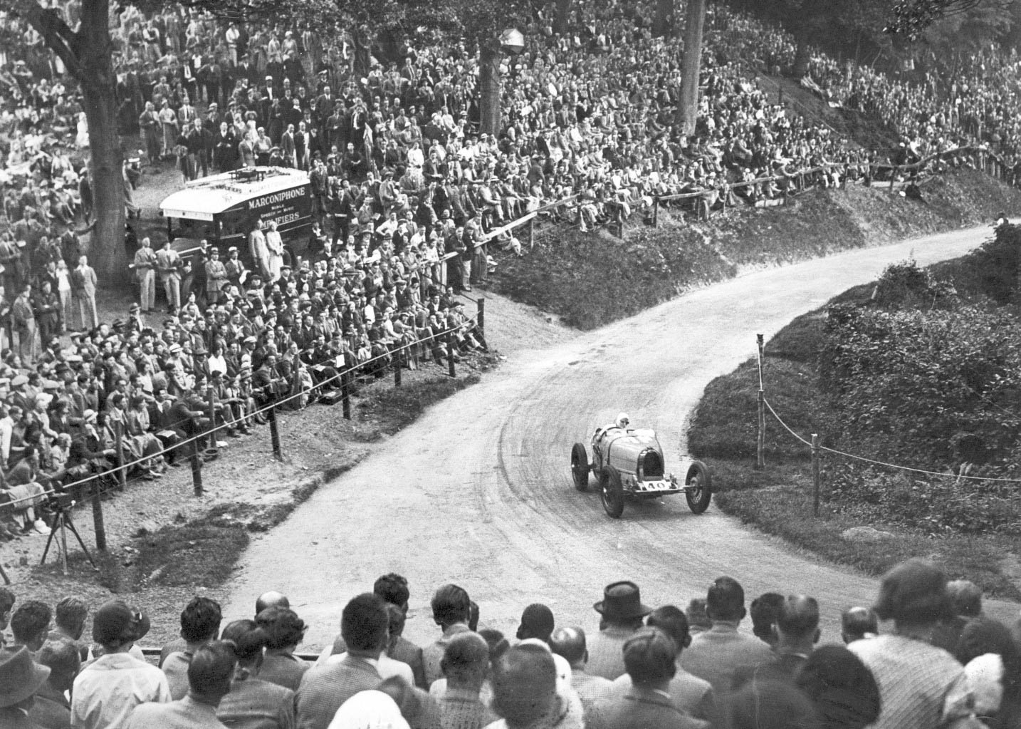 Fans line the Shelsley Walsh course to watch Kay Petre in her Bugatti Type 35 on June 9, 1934.