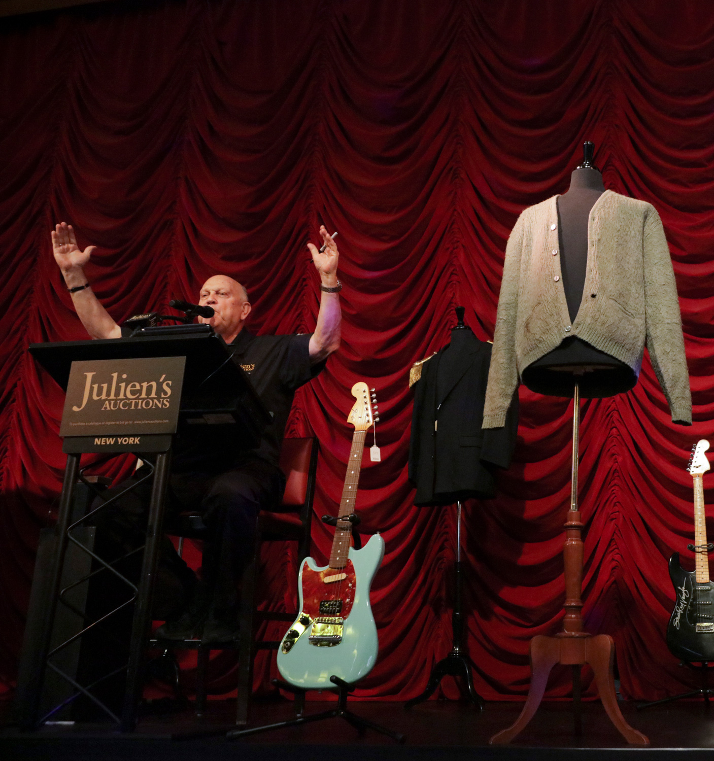 Auctioneer Daniel Kruse of Julien's Auctions and Kurt Cobain's Fender Mustang guitar and MTV Unplugged in New York at Hard Rock Café.
