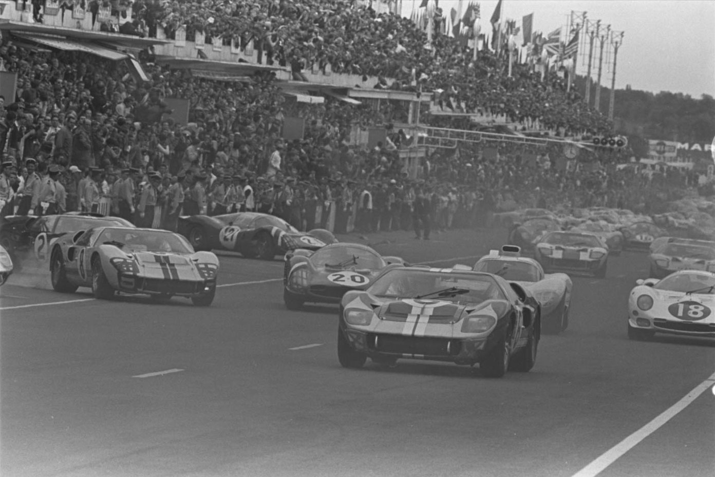 June 18, 1966. Ford and Ferrari jockey for position during the typically chaotic Le Mans start. The Holman- Moody No. 6 Ford GT40 shared by Mario Andretti and Lucien Bianchi gets away, but their car would retire in the eighth hour with a blown head gasket.
