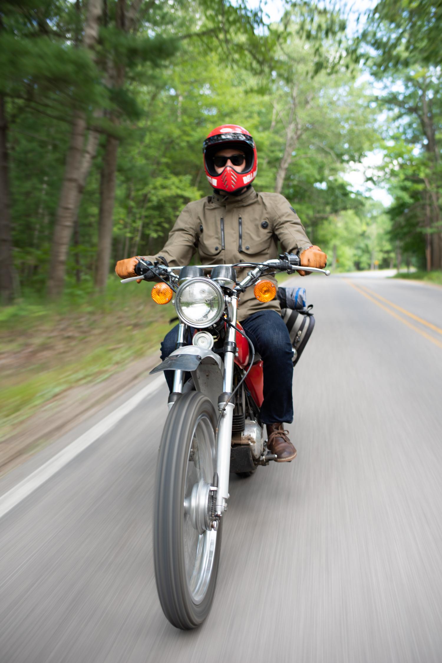 vintage kawasaki motorcycle rider