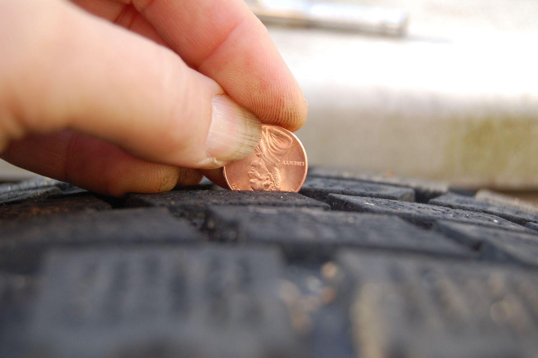 Penny in tire tread