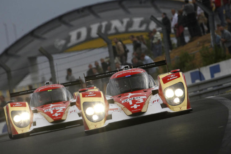 rebellion race cars front oncoming action