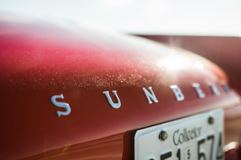 red sunbeam tiger rear emblem detail