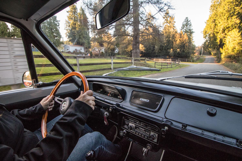 white subaru ff-1 interior driving action