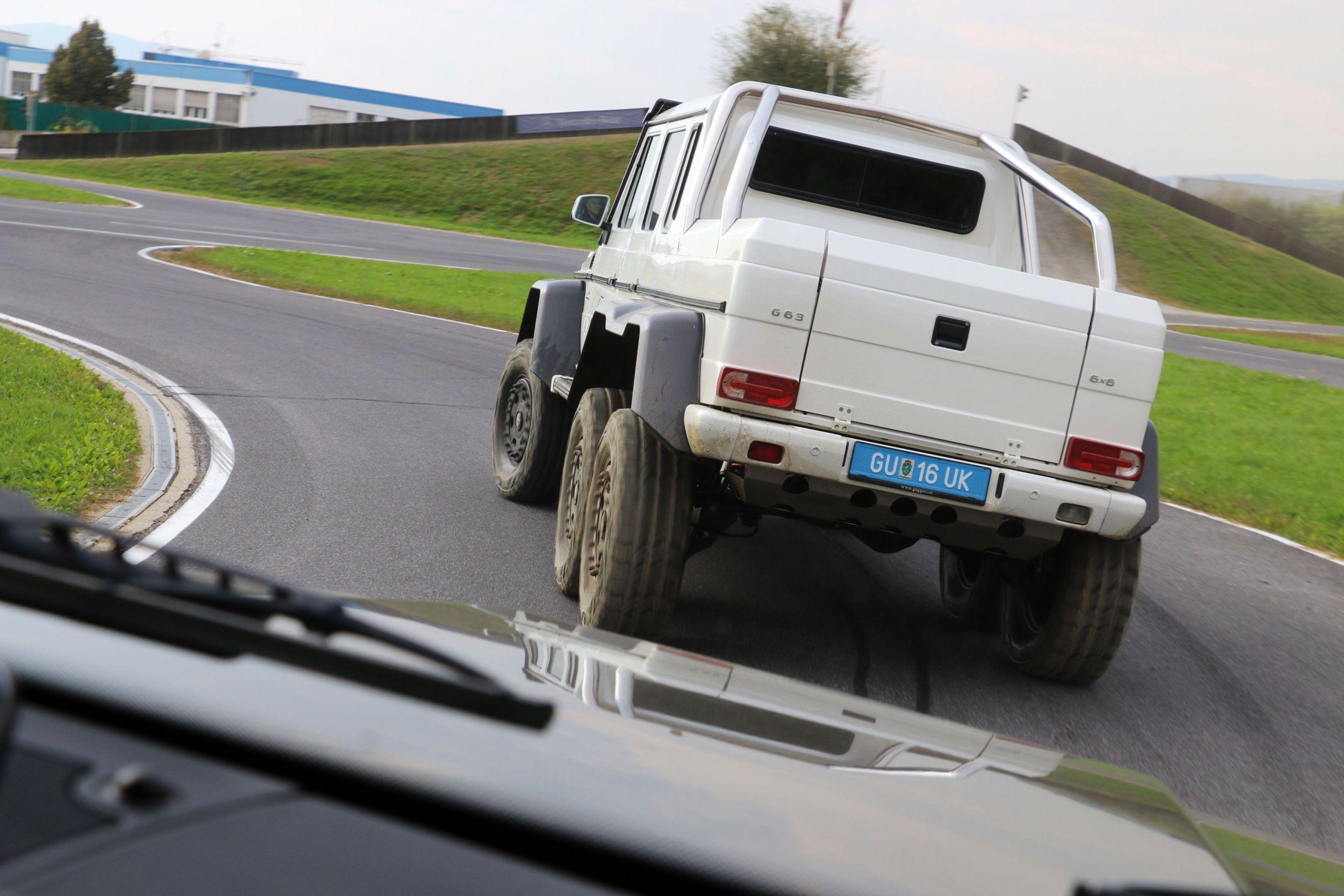 white truck rear cornering on track