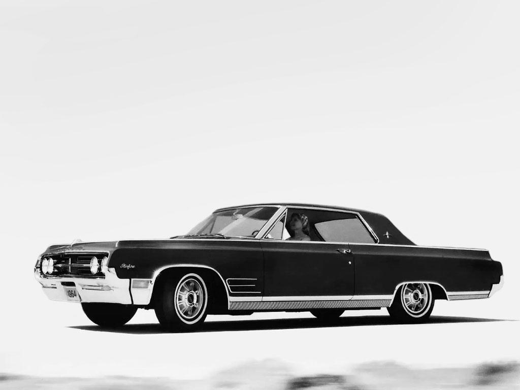 1964 Oldsmobile Starfire ad