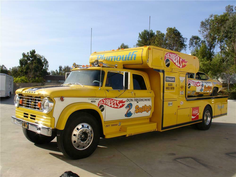 yellow two tone snake car hauler front three-quarter
