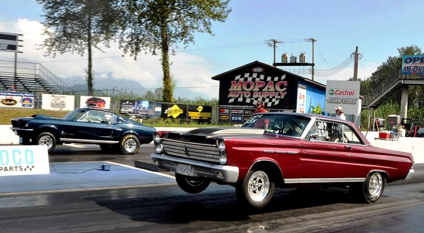 mustang and comet dragsters take off